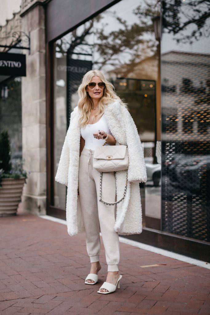Fashion blogger wearing a white teddy coat and oatmeal colored joggers