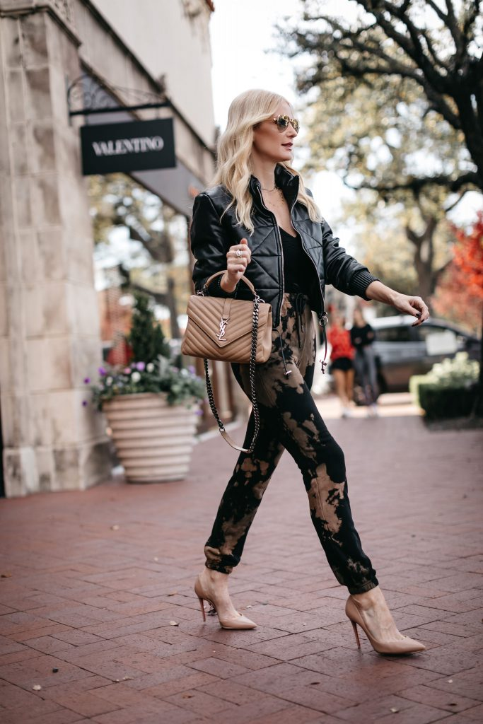 Dallas blogger wearing an affordable leather bomber jacket and chic joggers with heels