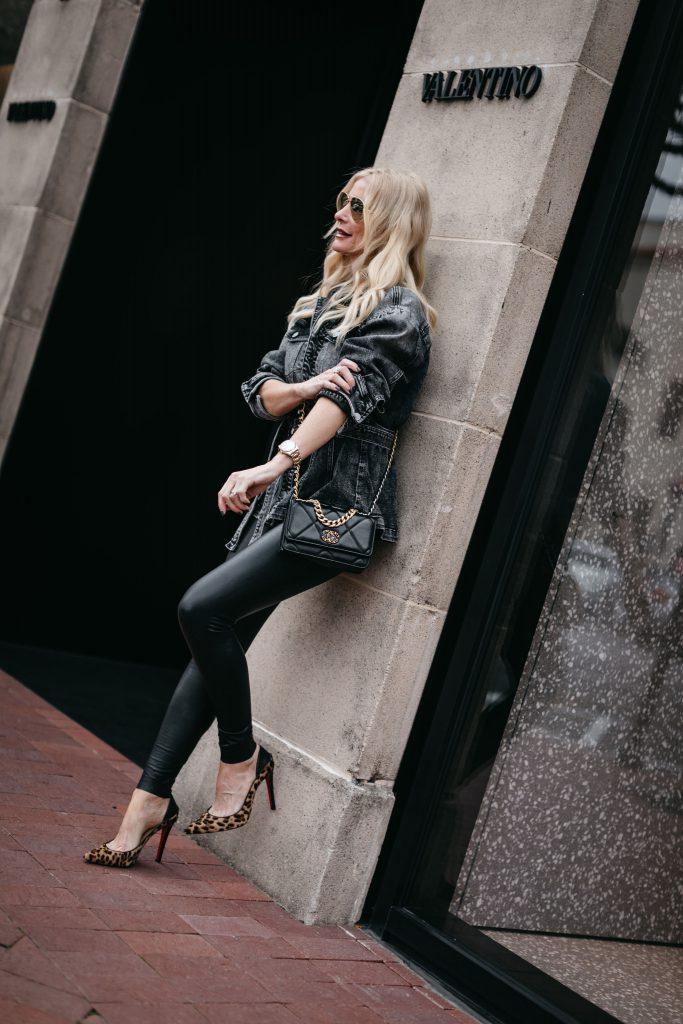 Dallas style blogger wearing cheetah print heels and a black denim jacket