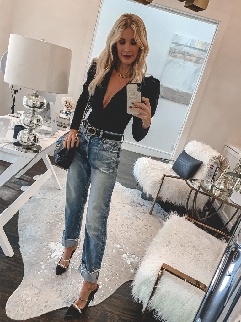 Dallas fashion blogger wearing a long-sleeve black bodysuit and baggy denim