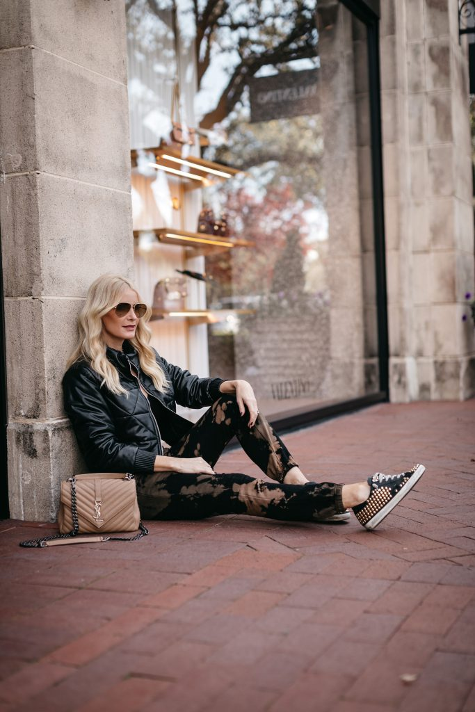 Dallas blogger wearing a faux leather bomber jacket and tie dye joggers