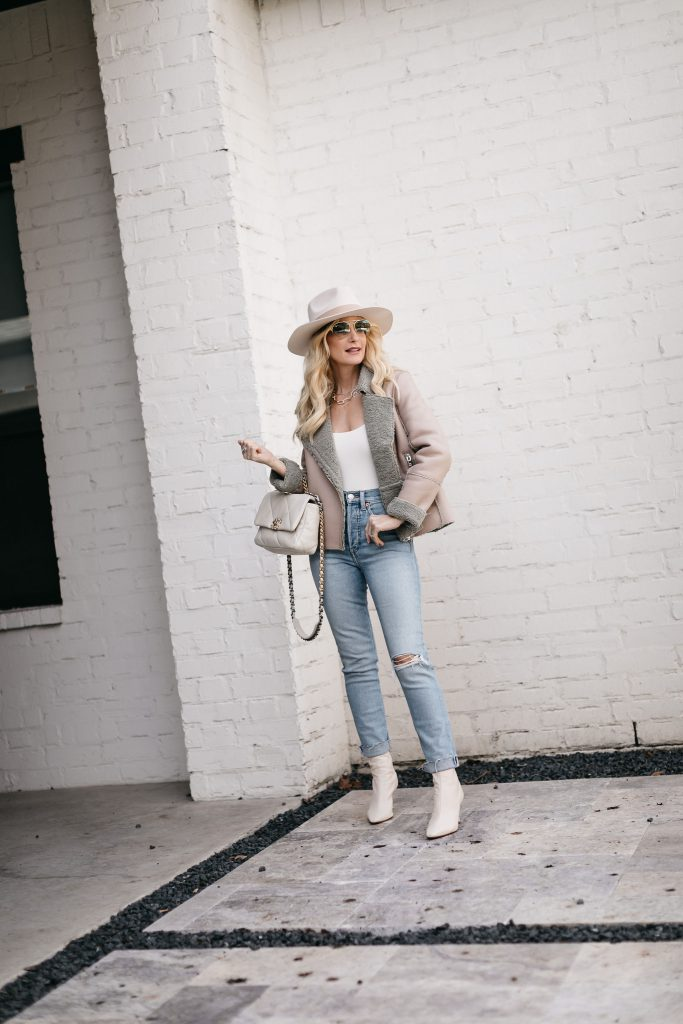 So Heather Blog wearing light wash denim and white booties for a neutral spring look