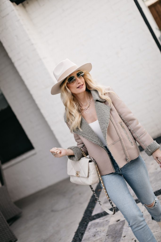 Dallas fashion blogger wearing a chic warm jacket and light wash denim for spring
