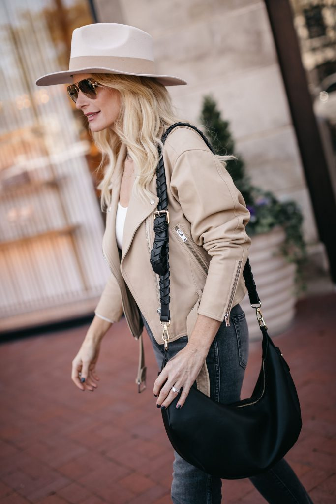 Dallas blogger wearing a black shoulder bag and a neutral Moto jacket from The Spring Curateur Box