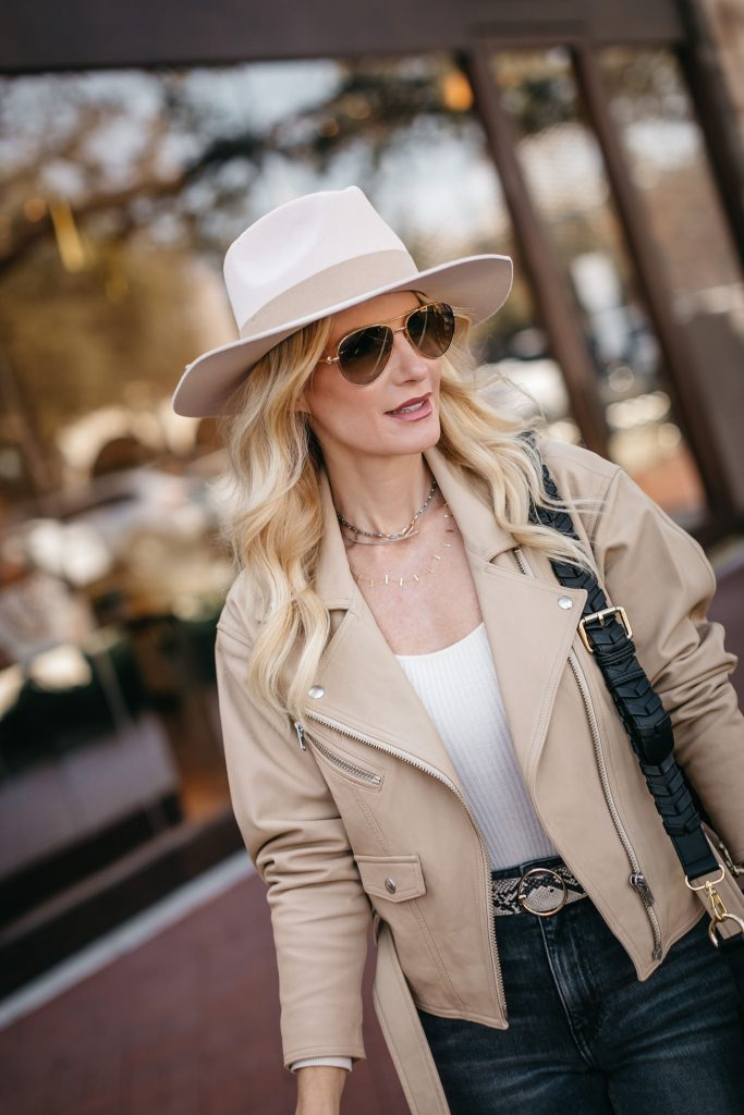 Dallas blogger wearing a faux leather blazer and a neutral hat