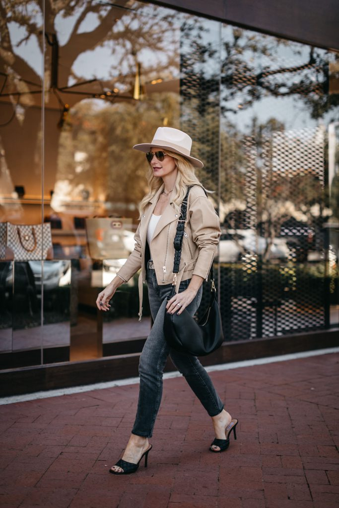 Dallas blogger wearing a neutral hat and a neutral Moto jacket for spring