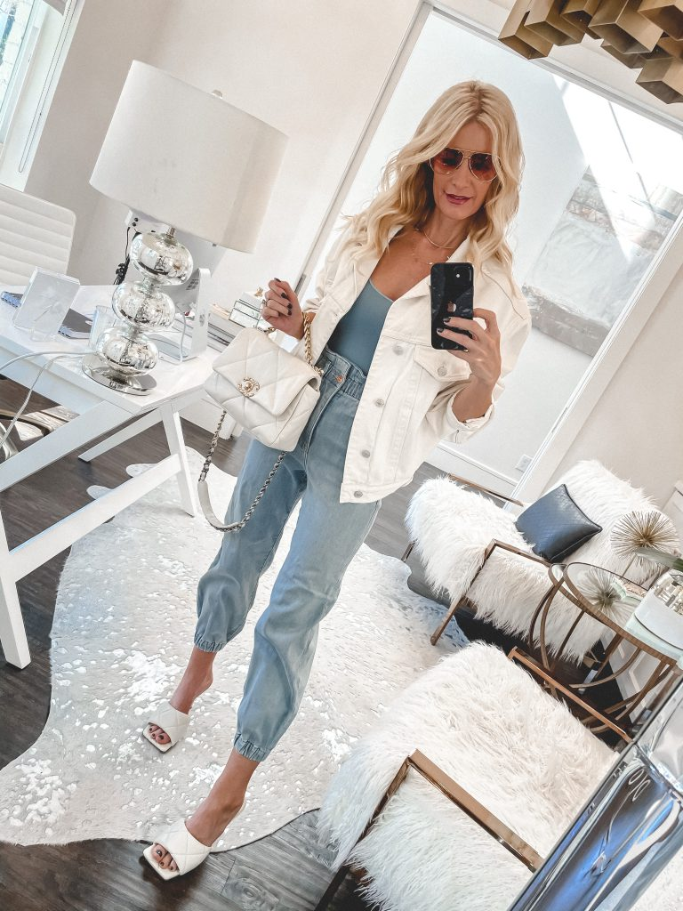 Dallas blogger wearing a white denim jacket and denim joggers