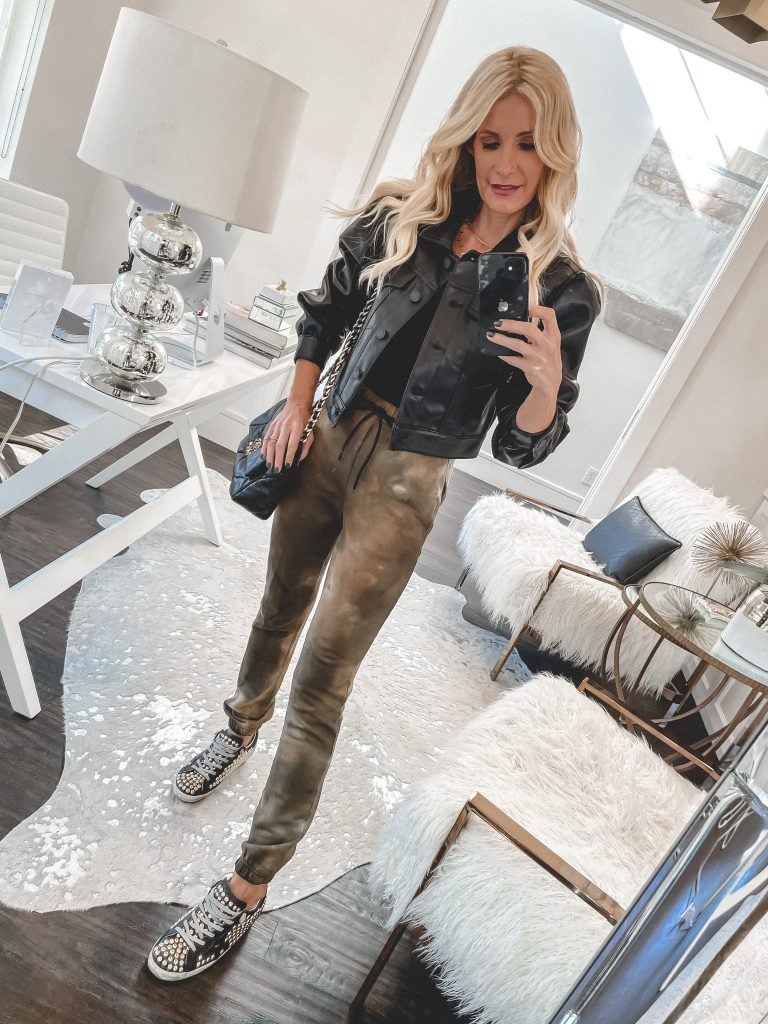 Dallas blogger wearing a leather shirt jacket and tie dye joggers