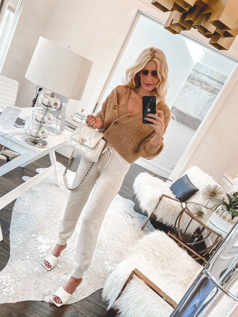 Dallas blogger wearing a cardigan set and cozy joggers with heels
