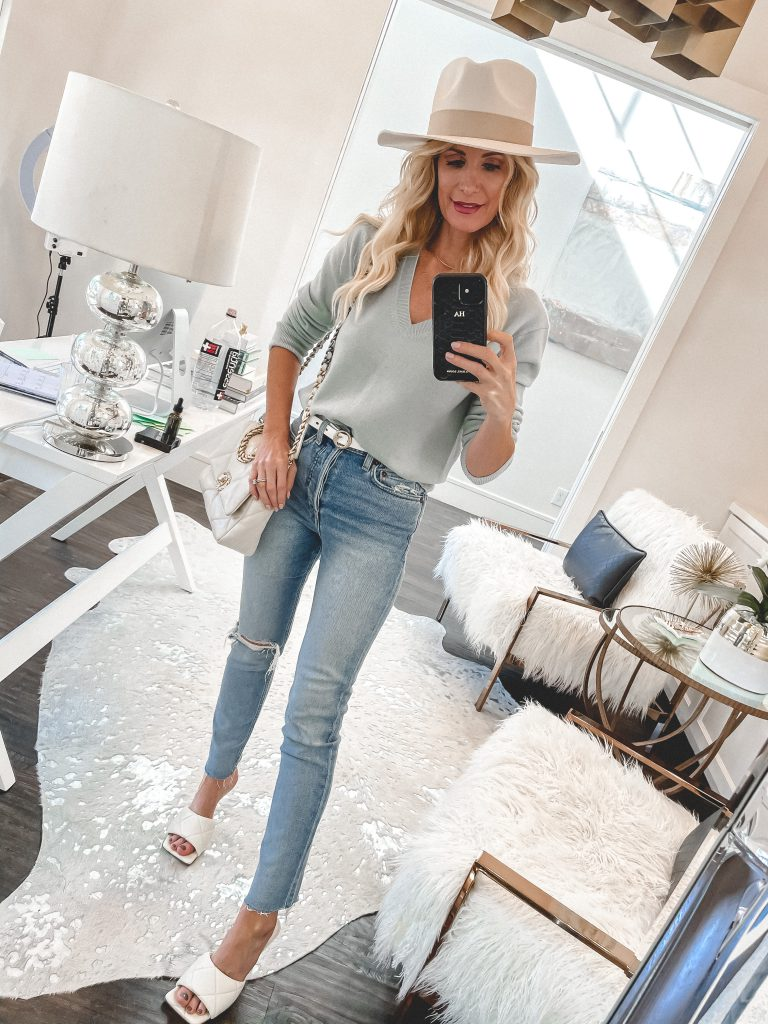Dallas blogger wearing a light blue sweater and a gorgeous hat as a spring accessory