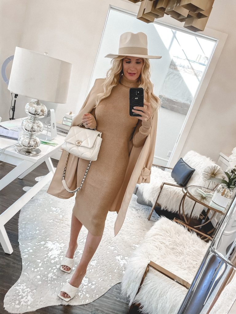 Dallas blogger wearing a camel colored sweater dress and white heels