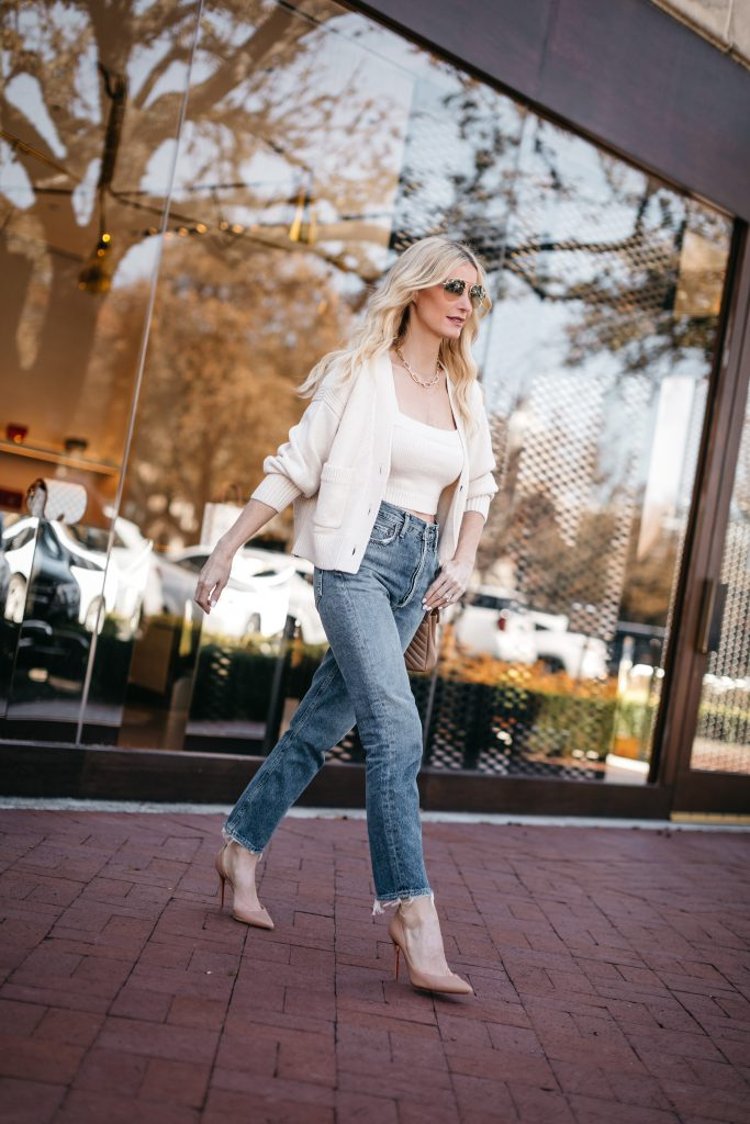 So Heather Blog wearing straight leg denim and a white cardigan set for date night