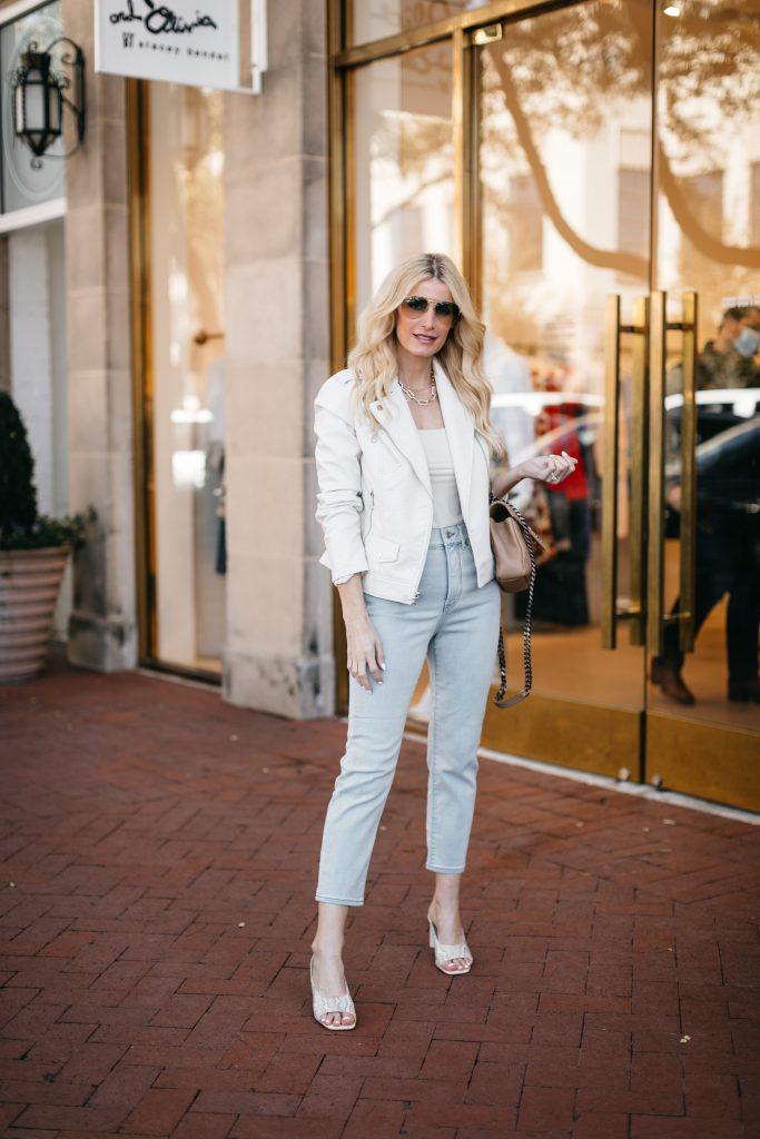 Dallas fashion blogger wearing light wash denim and a white blazer
