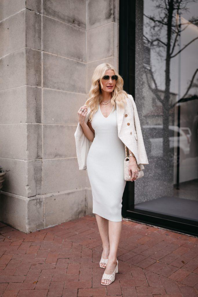Dallas blogger wearing a white bodycon dress and a white blazer for spring