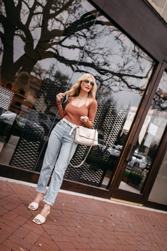 Dallas fashion blogger wearing light wash denim and a rust colored top for spring