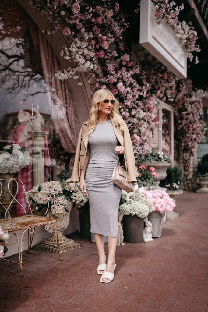Dallas blogger wearing a gray midi dress and a camel colored faux leather jacket