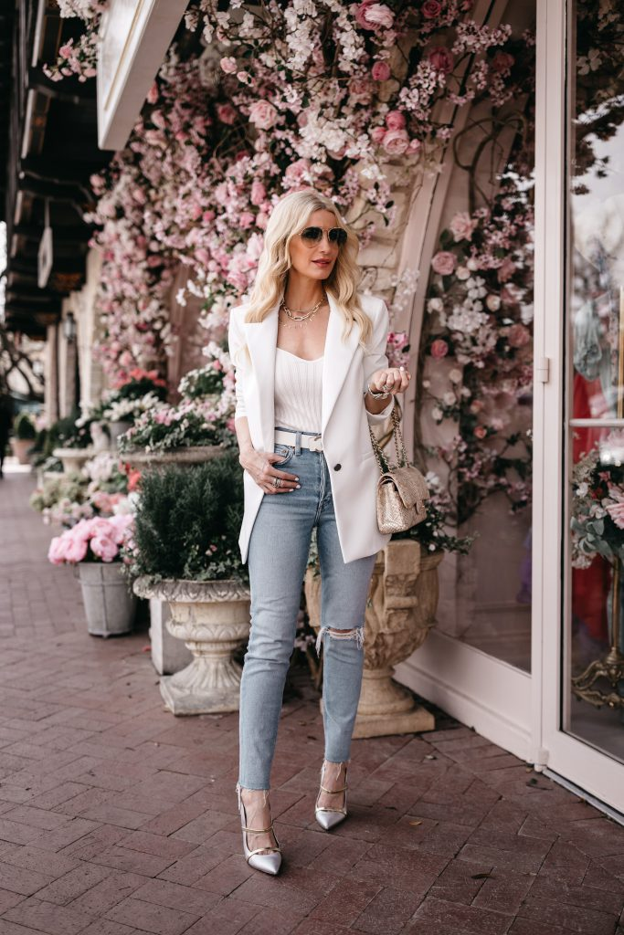 Dallas blogger wearing light wash denim and white accessories for spring
