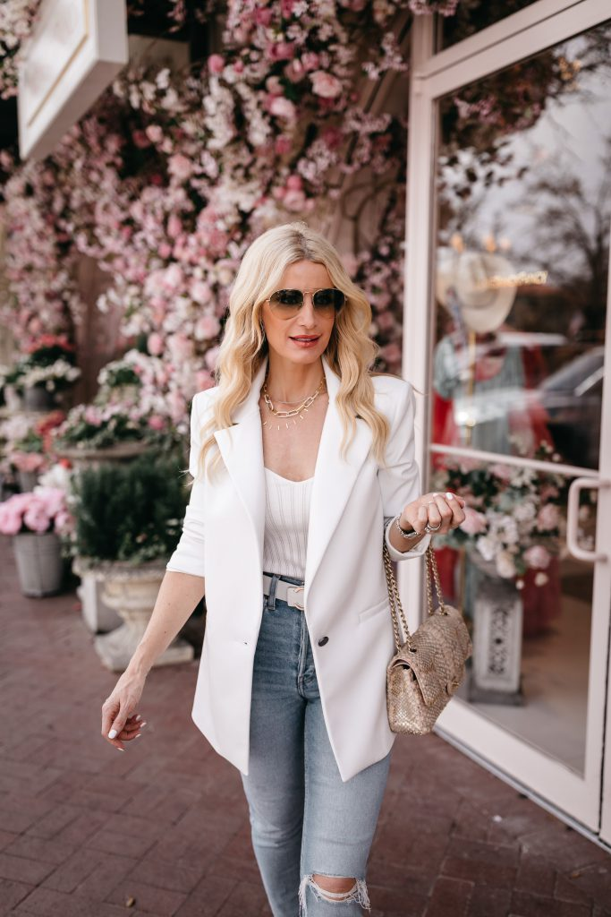 Dallas fashion blogger wearing a chic white blazer and gold chain accessories for spring