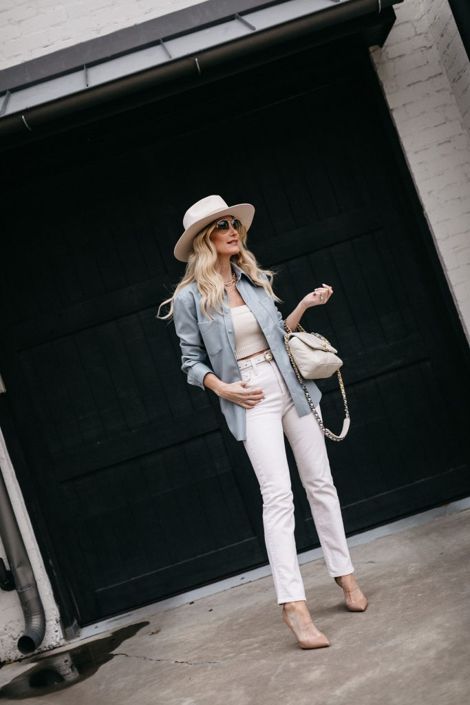 So Heather style blogger wearing white jeans and a light blue shirt jacket