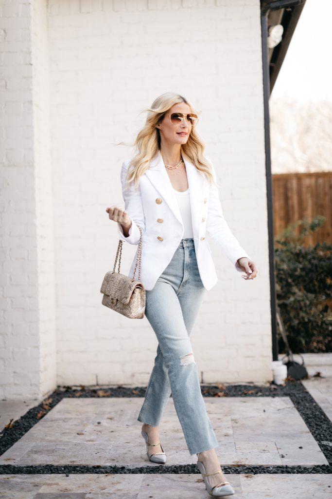 Dallas fashion blogger wearing a white blazer and light wash denim for spring