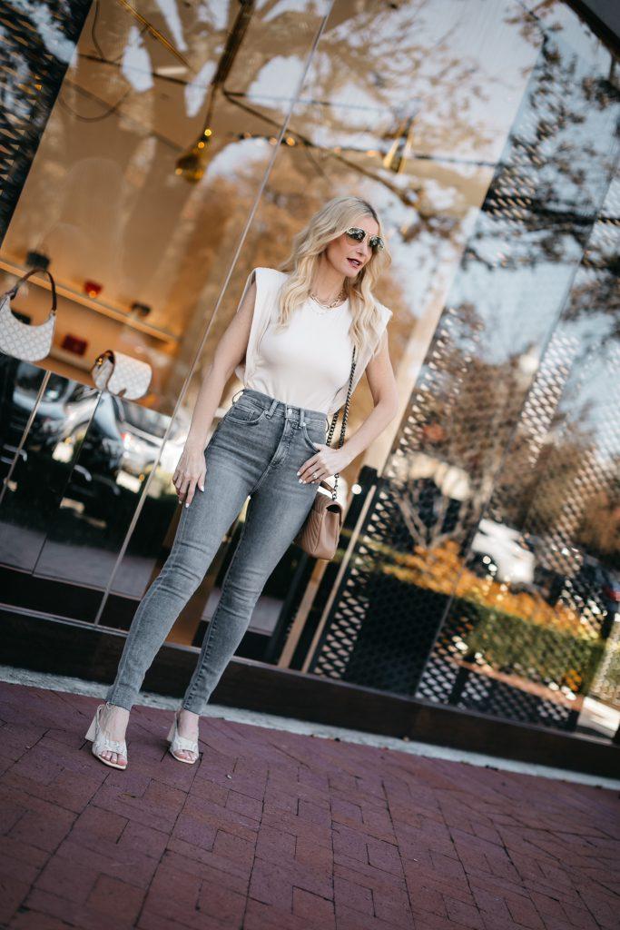 Dallas blogger wearing a neutral bodysuit and grey light wash denim