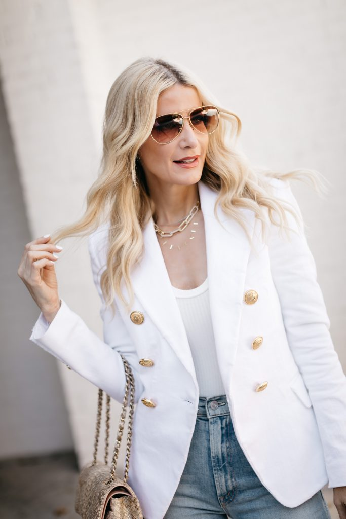 Style blogger wearing a Balmain blazer dupe and gold chain necklaces