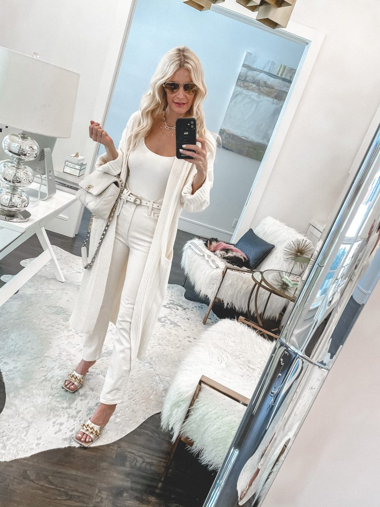 Dallas style blogger wearing a white bodysuit, white jeans, and a white cardigan for springtime