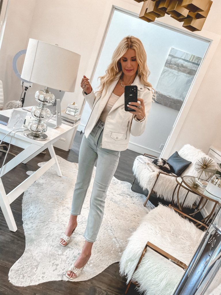 Dallas style blogger wearing light wash denim and a white jacket for spring