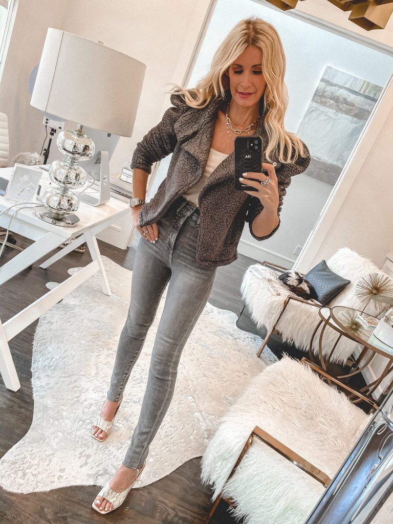 Dallas blogger wearing a grey puff sleeve jacket from Express and snake print mules