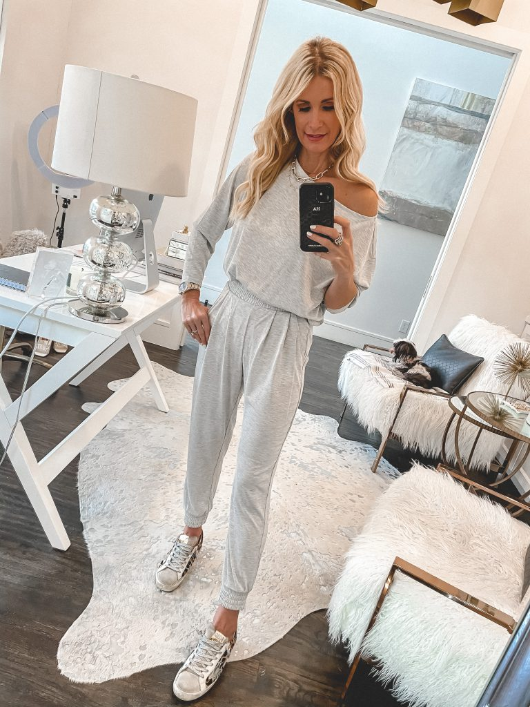 Fashion blogger wearing a light grey loungewear set and Golden Goose sneakers
