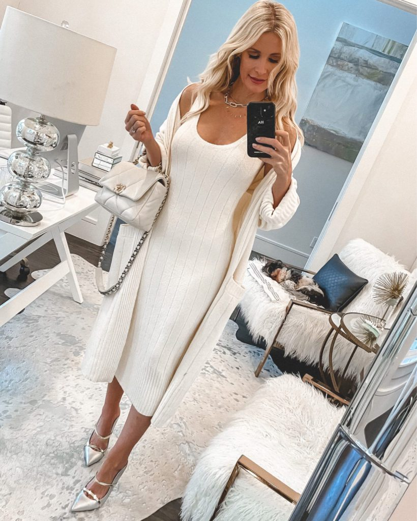 Dallas fashion blogger wearing a slimming white dress and a neutral cardigan for spring