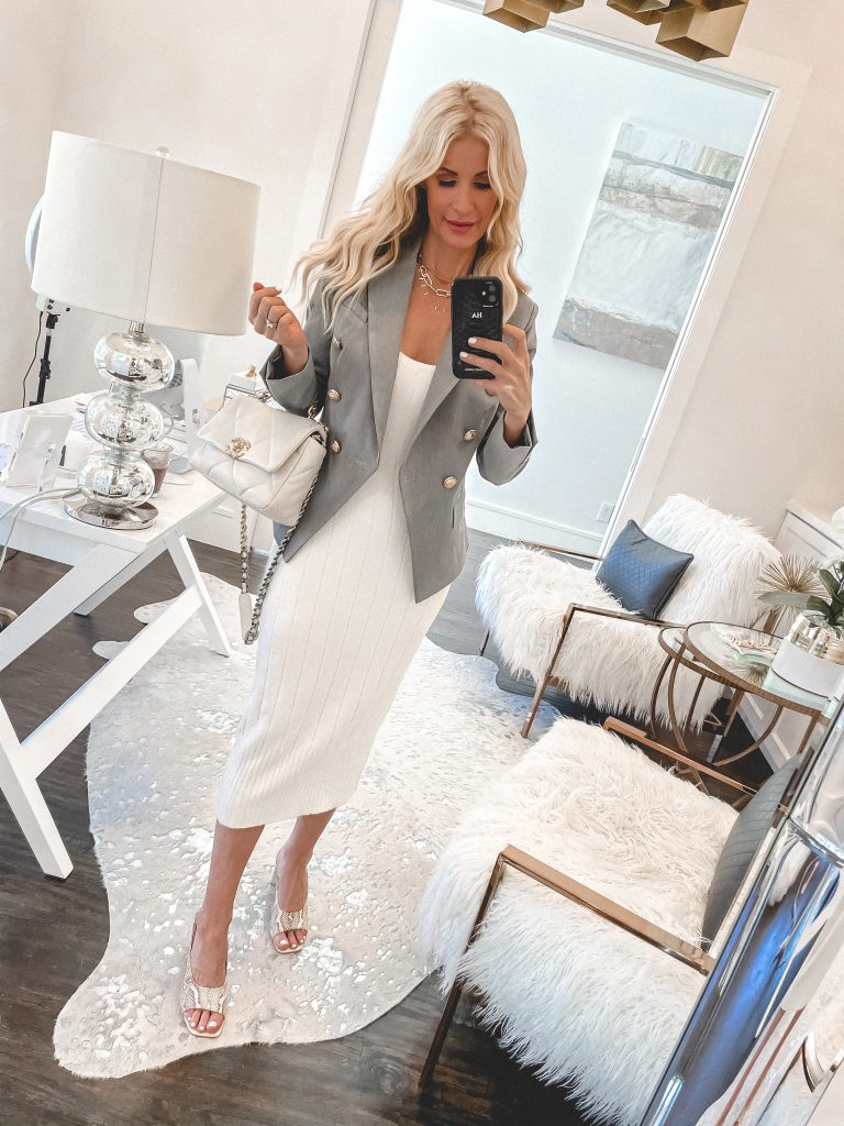 Dallas fashion blogger wearing a grey blazer and a white midi dress for spring