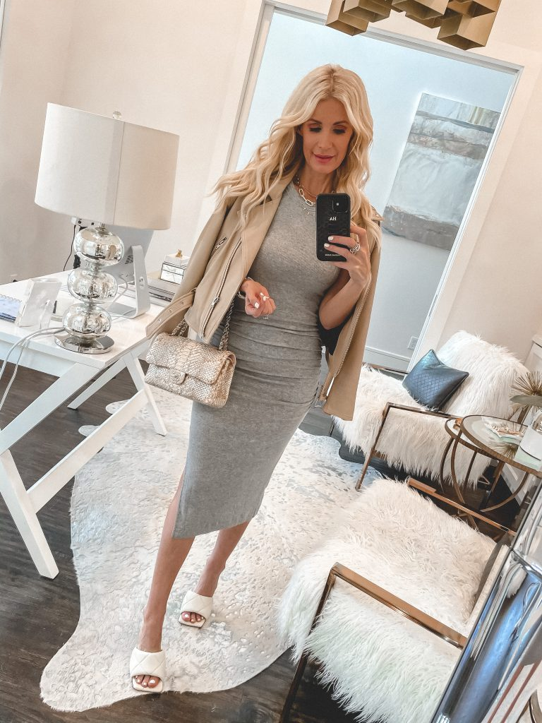 Dallas blogger wearing a grey midi dress and a faux leather tan jacket