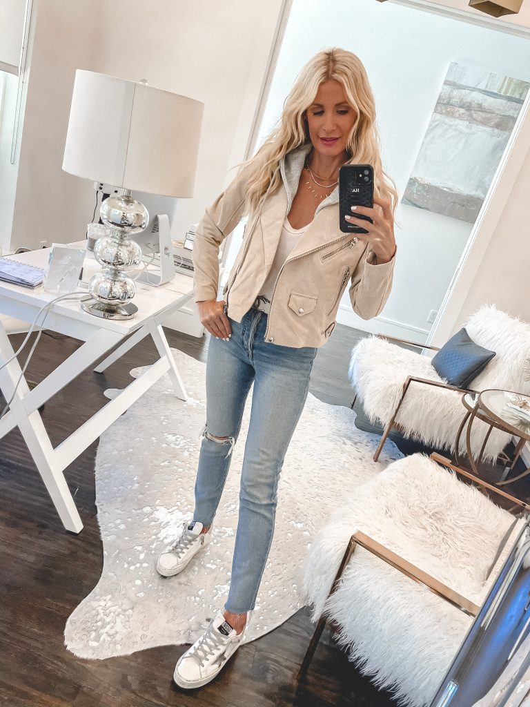 Lifestyle blogger wearing a cream suede jacket and golden goose sneakers