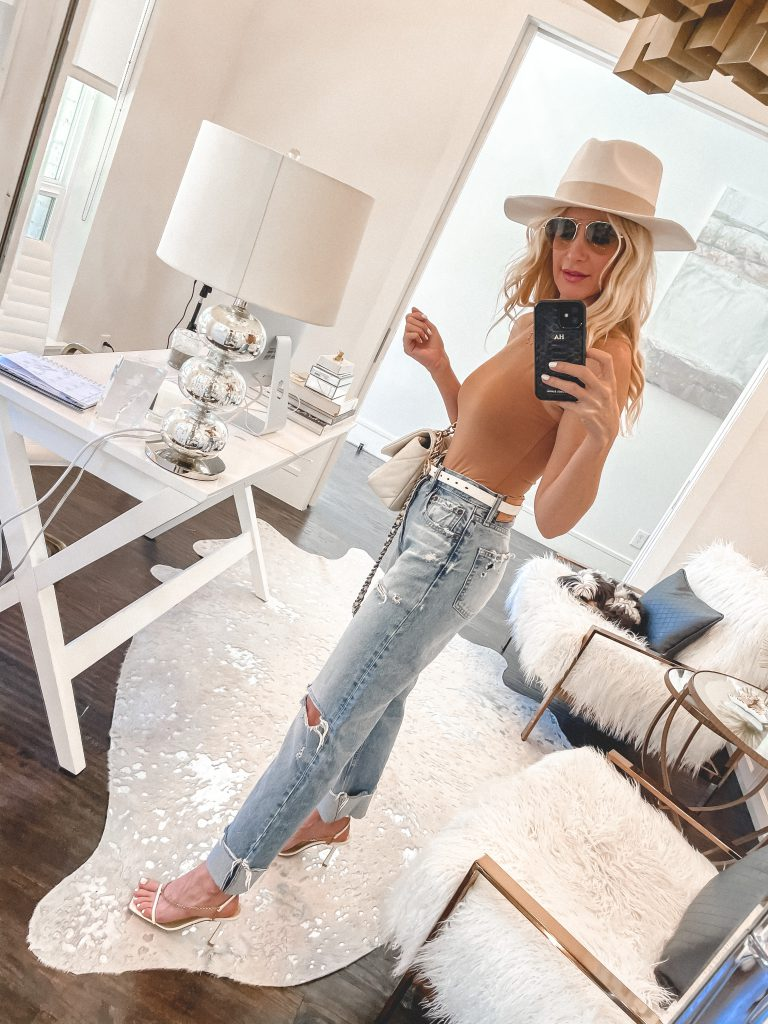 Dallas style blogger wearing light wash denim and a camel colored bodysuit
