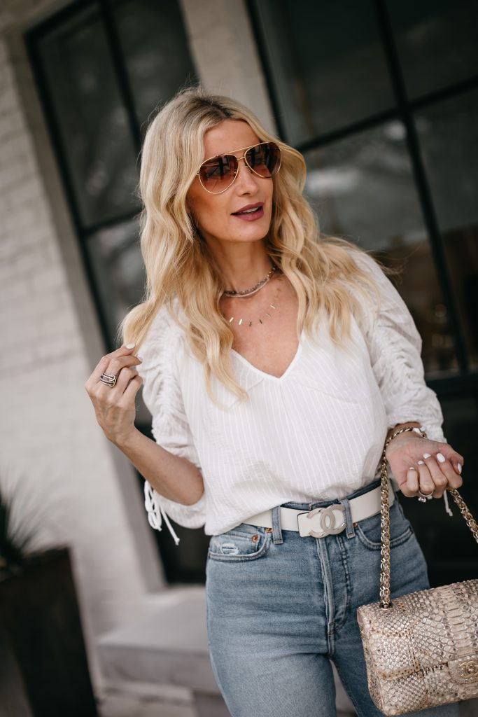 Dallas fashion blogger wearing a ruched white top and light blue denim