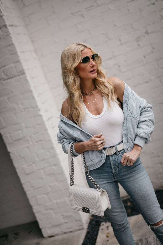 Dallas blogger wearing a denim jacket and a white bodysuit