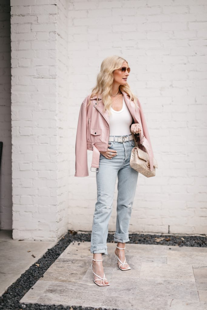 Dallas blogger wearing light wash straight leg jeans and white sandals