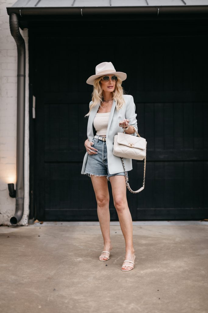 Dallas fashion blogger wearing a blue blazer and denim shorts by Agolde