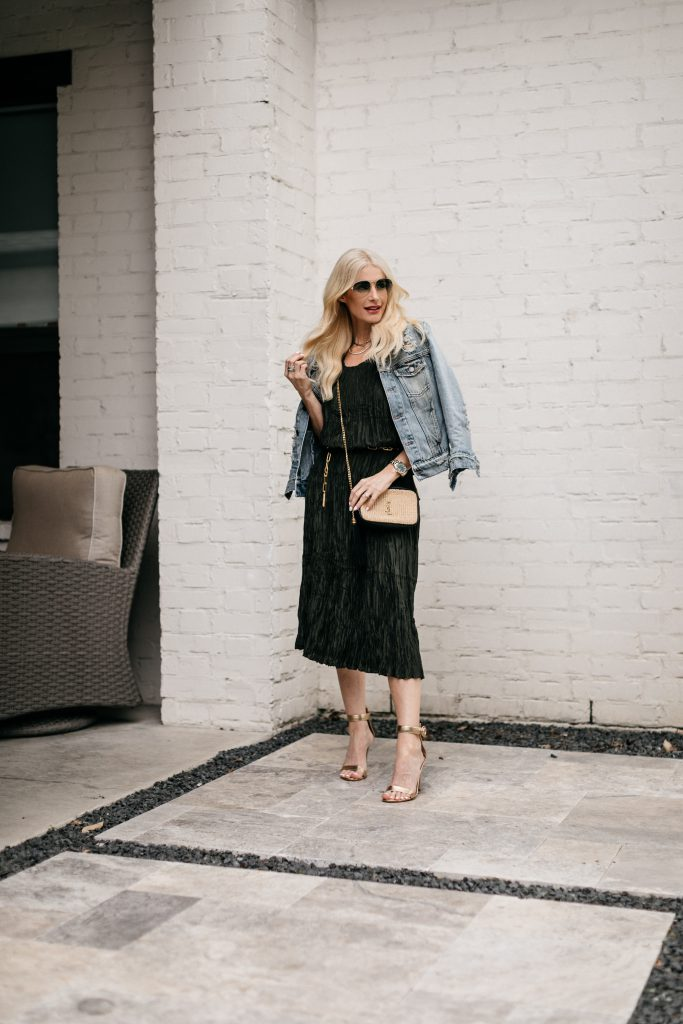Dallas fashion blogger wearing a denim jacket, a chic dress, and gold heels for spring and summer