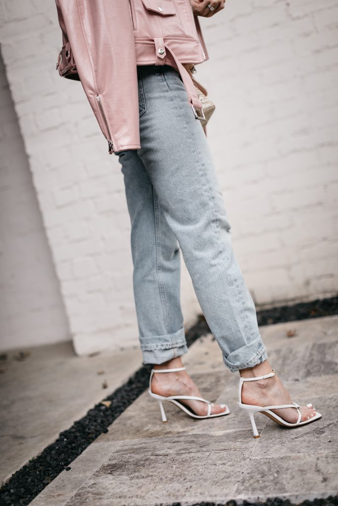 Dallas blogger wearing light wash straight leg denim with white strappy sandal heels