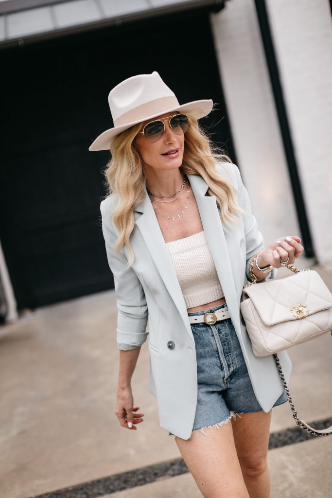 Dallas fashion blogger wearing a light blue blazer and a neutral hat for summer