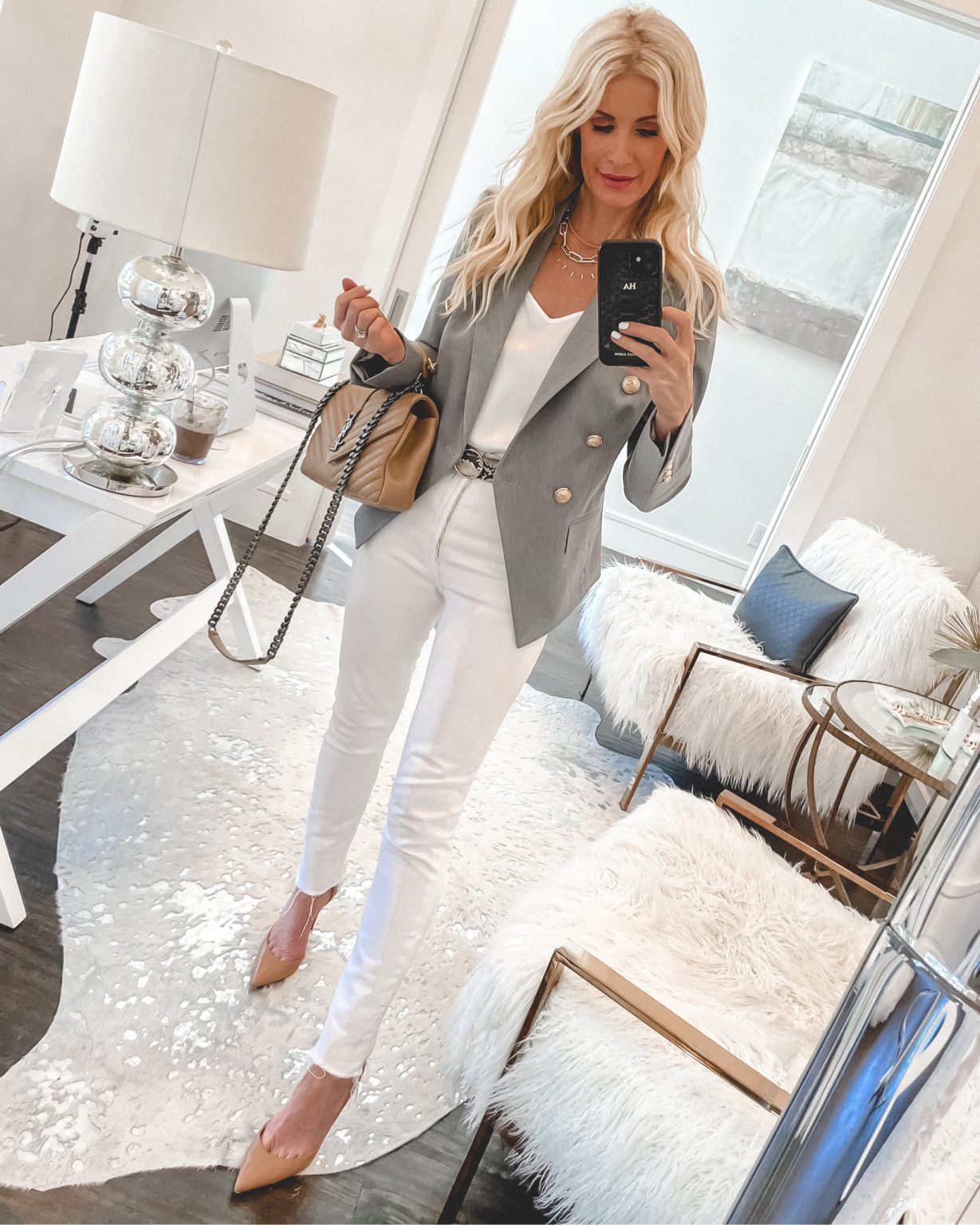Dallas blogger wearing a grey blazer and white pants for spring