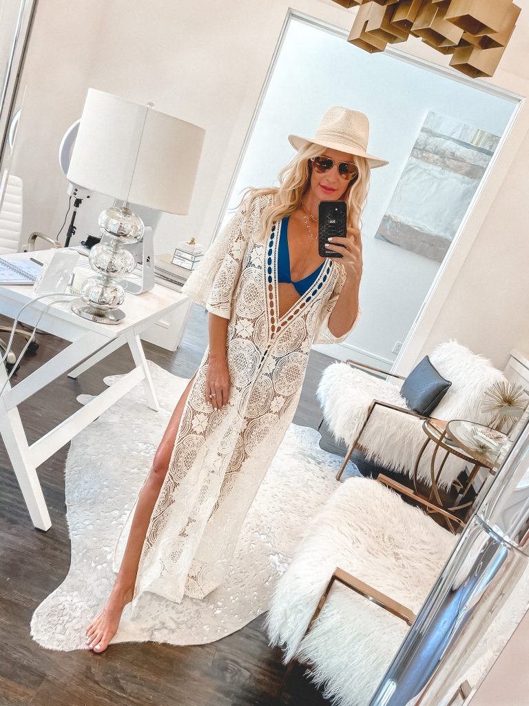 Dallas fashion blogger wearing a white cut out cover up and a blue bikini for summer