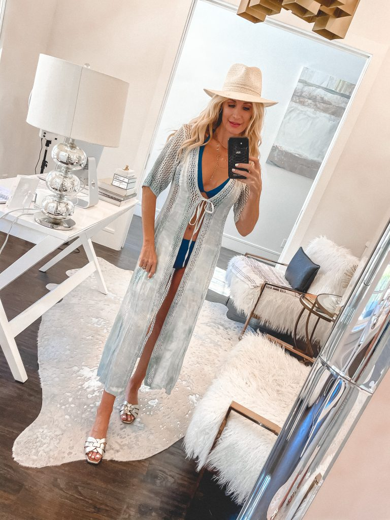 Dallas blogger wearing a light blue coverup and gold sandals for summer