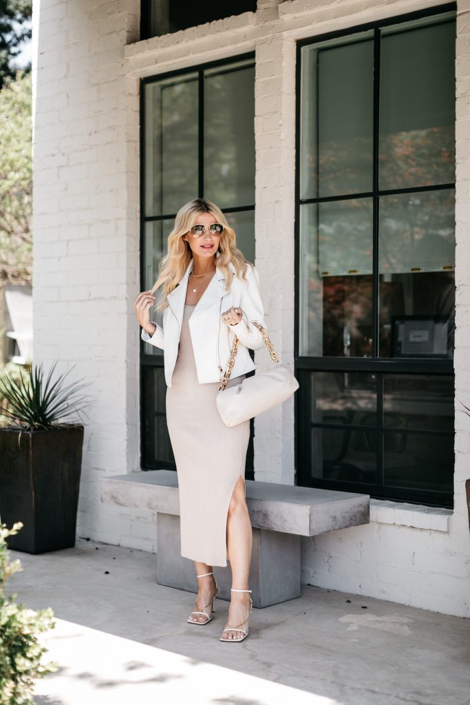 Dallas blogger So Heather Blog wearing a cream midi dress and a white leather jacket