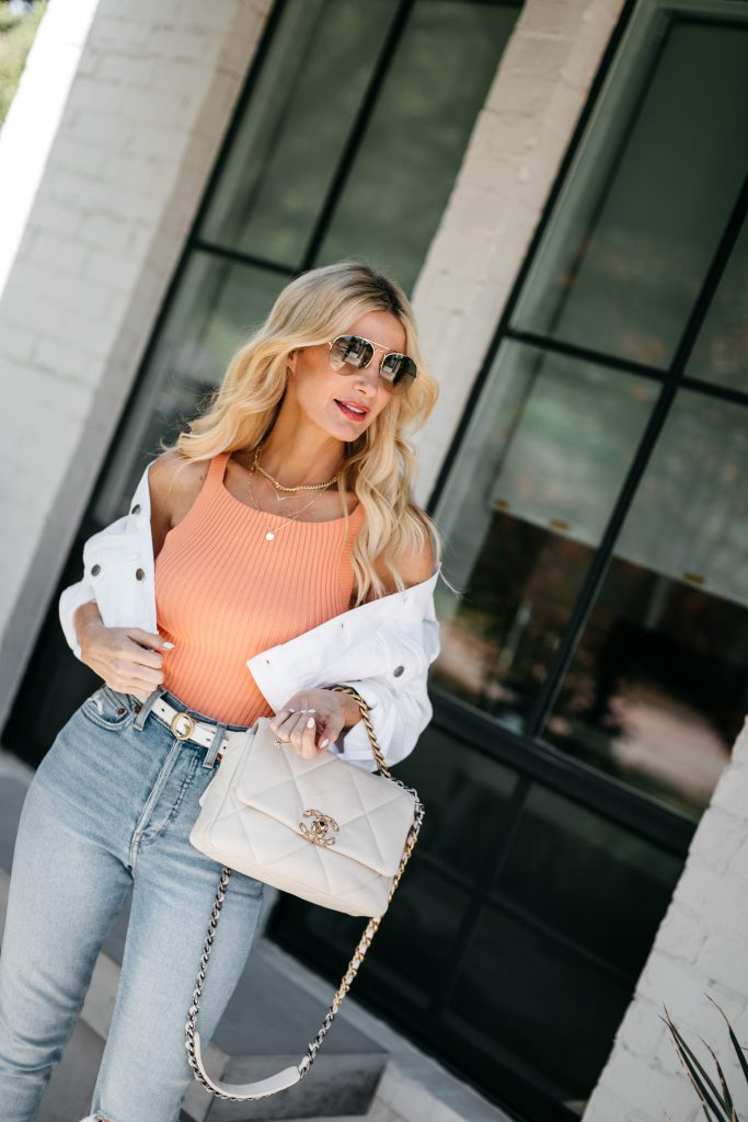 So Heather Blog wearing a ribbed tank with a white denim jacket