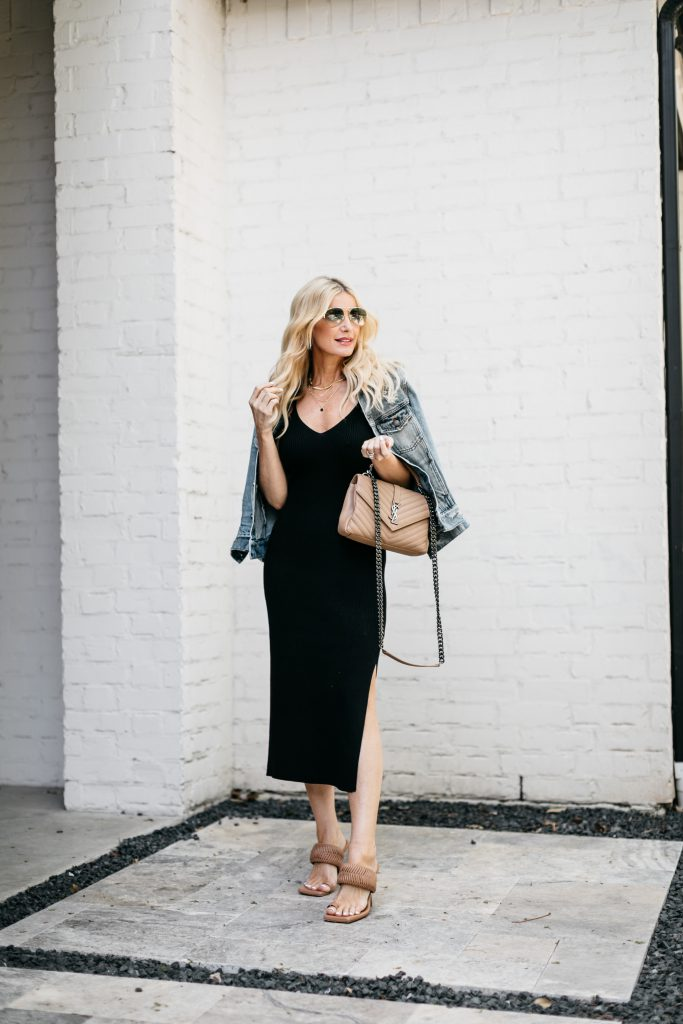 Dallas style blogger wearing a black midi dress and a light wash denim jacket for spring and summer date nights