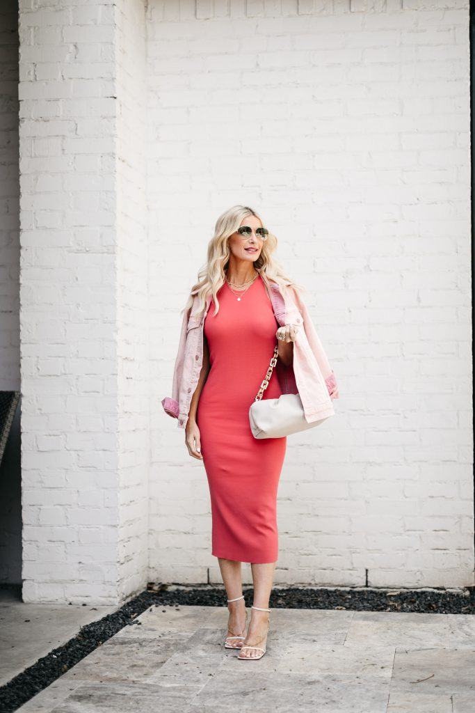 So Heather blog wearing a pink midi dress and pink denim jacket for spring and summer