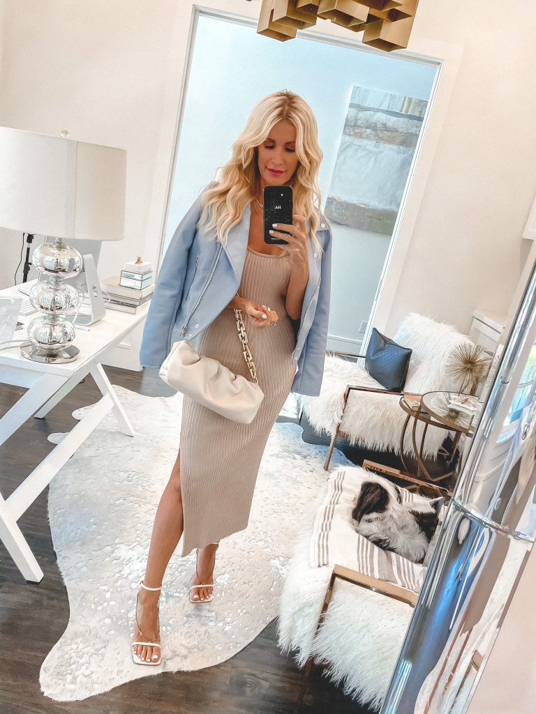 Style blogger wearing a blue leather Moto jacket and a neutral body con dress